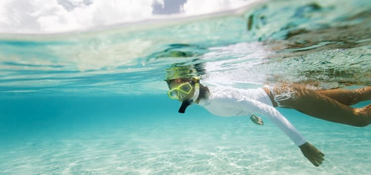 How to Use Sunscreen When Scuba Diving UV Clothing